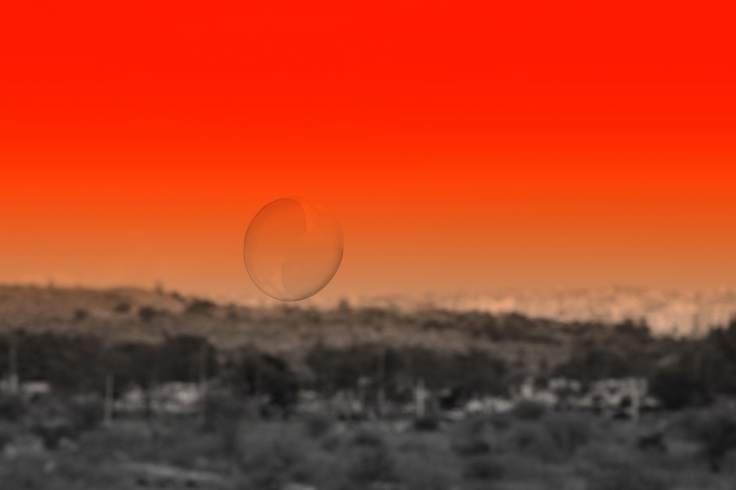 Flight of the bubble-against a red sky.