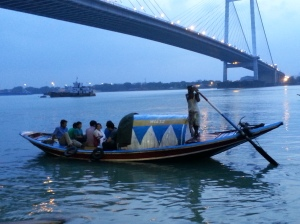 Local fishing boat sailing under the Vidyasagar Setu- or the new bridge as the locals still call it.