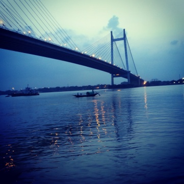 Sunset near the Prinsep Ghat- small boats, ferries, barges can be seen throughout the day.